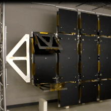 Deployable Antenna in mid phase II deployment with panel 1 deploying